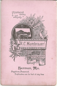Reverse of an R. C. Mumbrauer cabinet card portrait of a young child.
